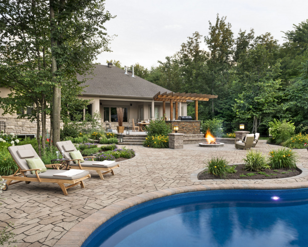 Large patio area by the pool, Fire pit sitting Area, Raised outdoor dining area.