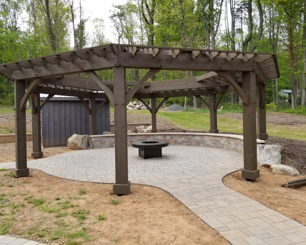 This is the  Pergola / Firepit area, that will soon be finished in phase II. The gas firepit get surrounded by beautiful high end wicker furniture.