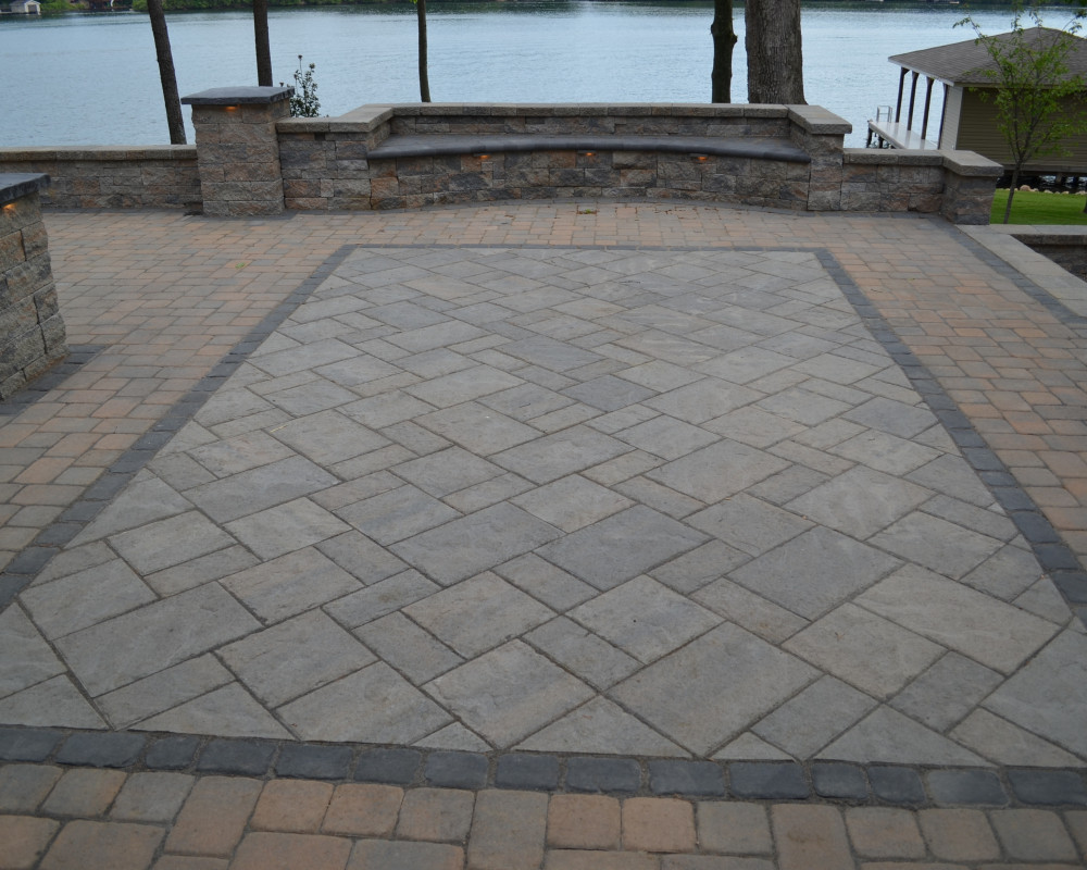 An inlay like this creates the same effect as a carpet or flooring detail in a grand room.  This area is designed for the occasion event with a dining table of buffet set up.  The setting is on Lake Anna in Spotsylvania, Virginia.