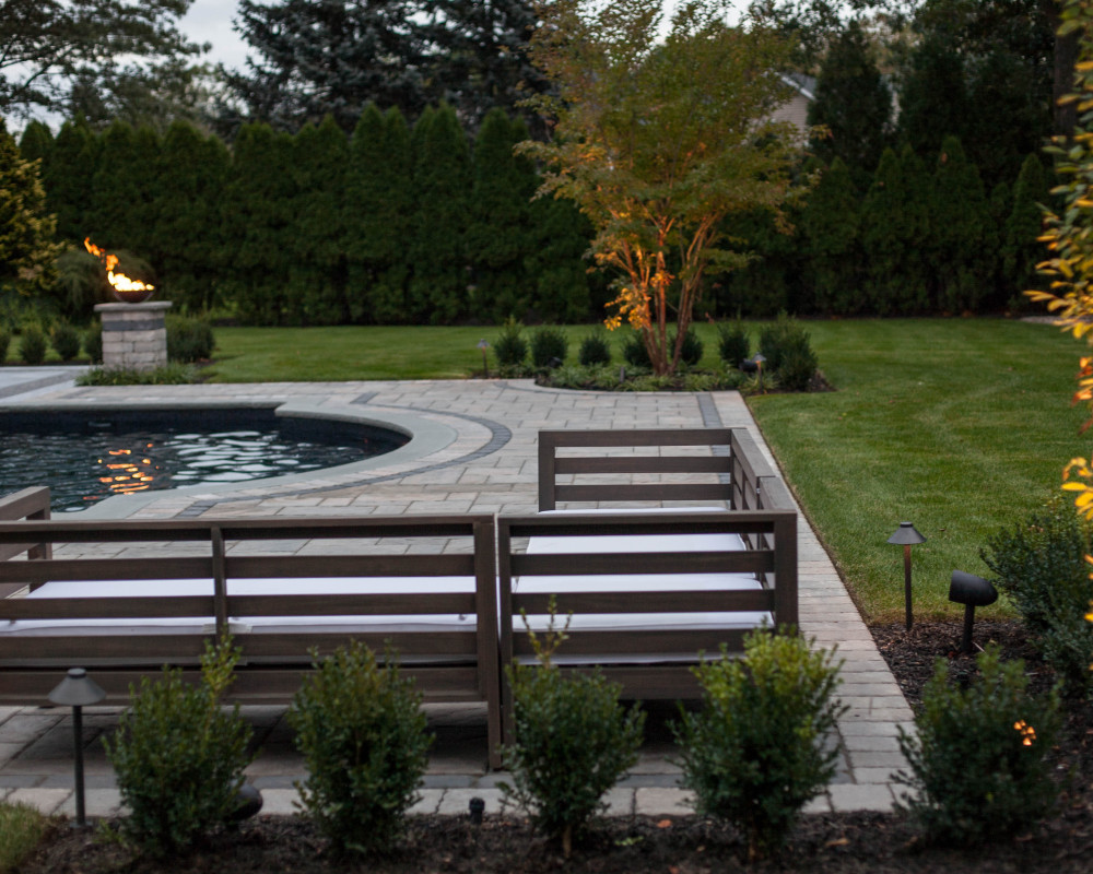 Plenty of space to have guests with different areas to enjoy the view of the backyard.
