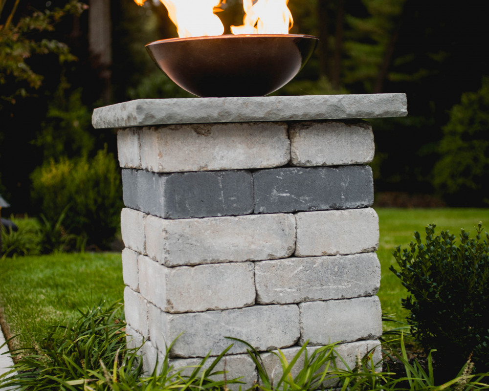 Add the wow factor to your yard with a fire bowl, and watch the reflections off the pool water to simulate being on vacation in your own yard!