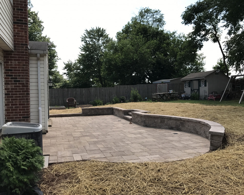 This back yard with drainage issues was transformed with a creative use of space, and materials.