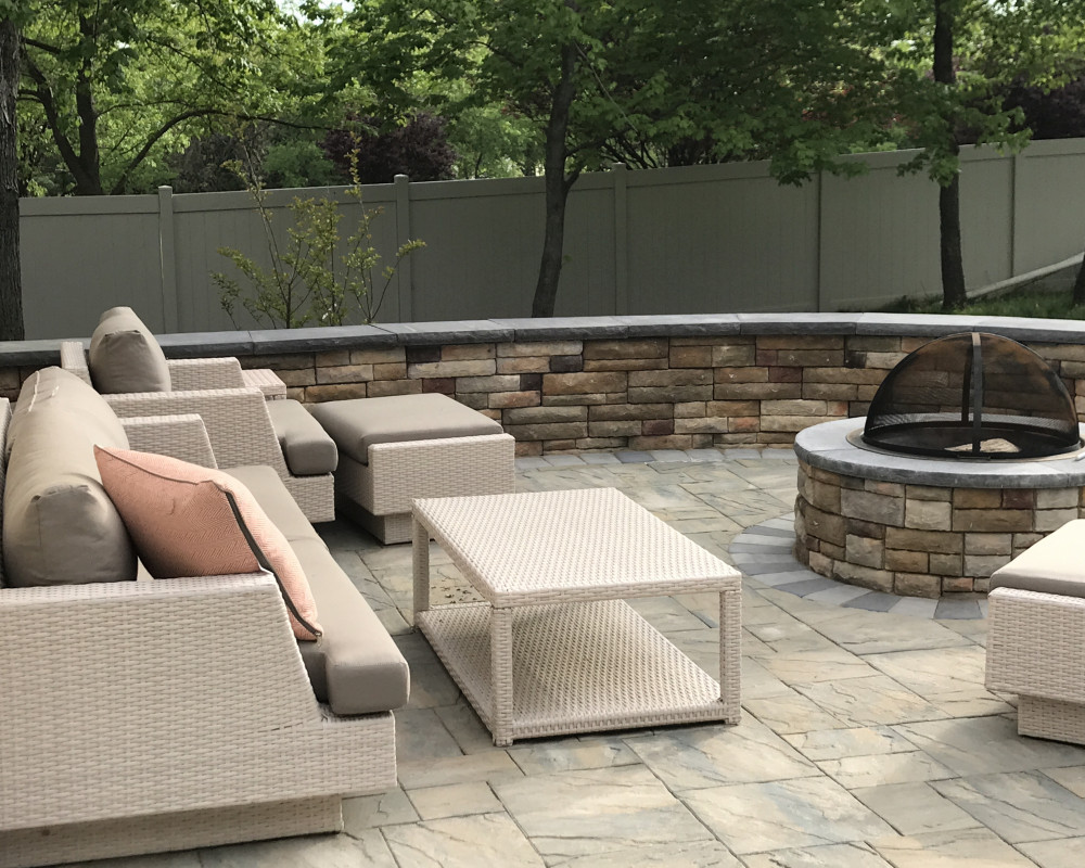 Custom fire pits and furniture transform this paver patio into a great spot to escape and unwind