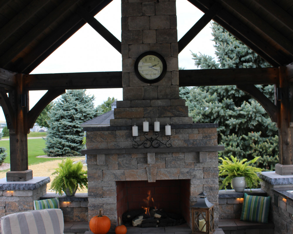The highlight of this pavilion is the custom gas fireplace. The fireplace includes unique features such as a keystone, lintel, and architectural accents in the chimney.  Wall block was ripped and used to face the chimney to create a seamless look with the surrounding seating walls.