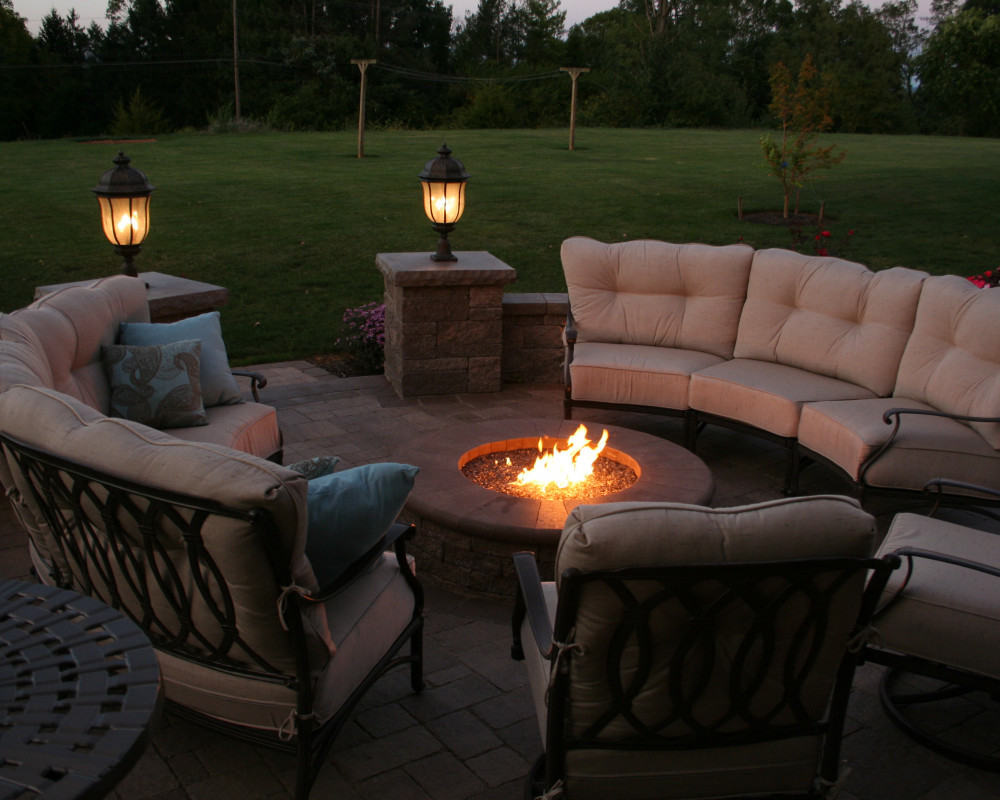 This cozy patio provides room for cushioned seating around a gas fire pit.