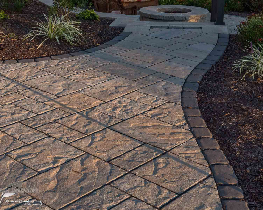 Amazing textures featured here include Blu 60 slate textured pavers along with a Villagio paver border