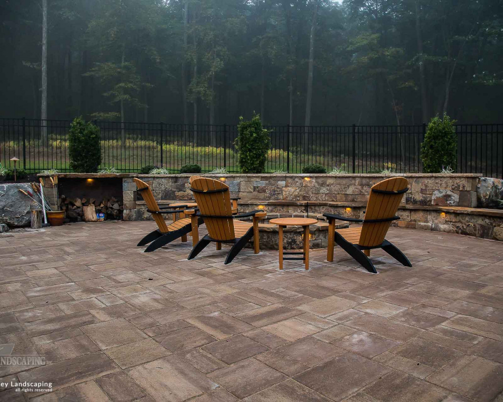 A large fire pit area comprised of Techo-Bloc Blu 60 pavers
