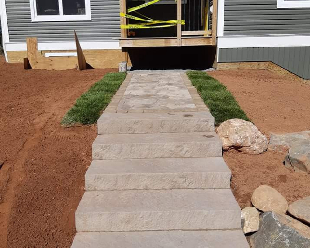 New walkway install with steps on a new home construction.