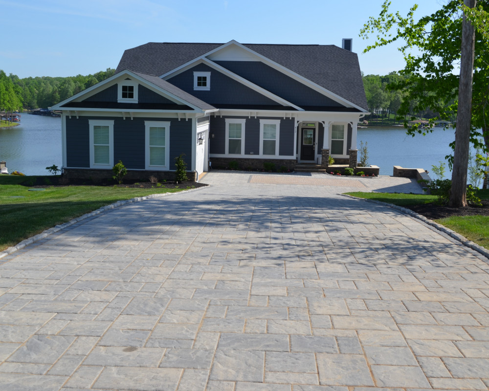 This driveway is accented with a Villagio Onyx Black border and Belgik Edging in the Slate Grey.  Champlain Grey is the choice for the main paver with Antika inlay in the parking area.  Set on Lake Anna in Mineral, Virginia.