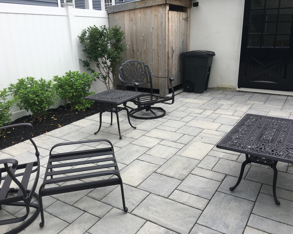 Black anodized garage door conversion to compliment paver tones