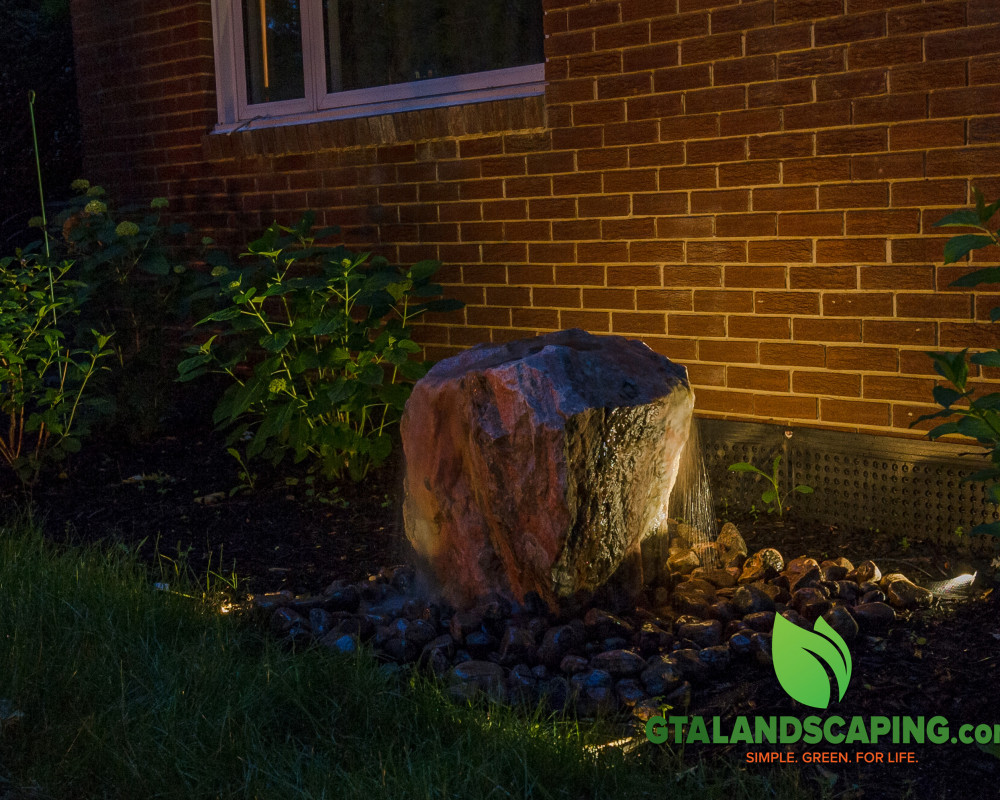 Bubbling rock water features add sound and effects to your back yard enjoyment