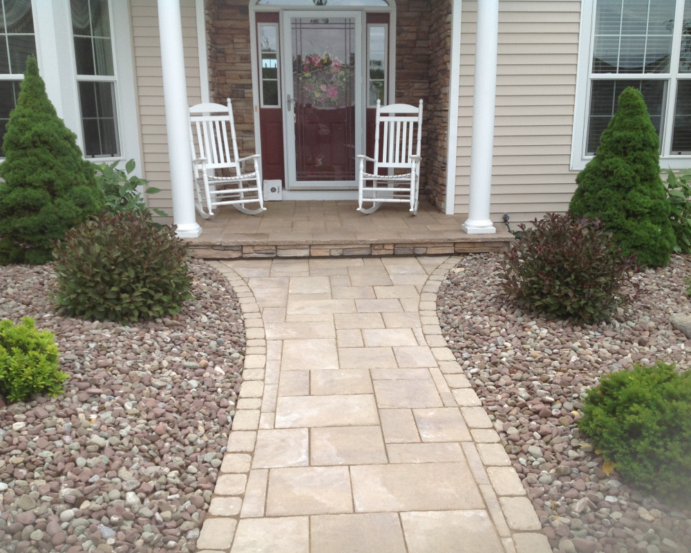 Front porch overlay with Blu45 to match new walkway. We also covered the riser with cultured stone to complete the makeover. Blu60 Walkway with Villagio Border.