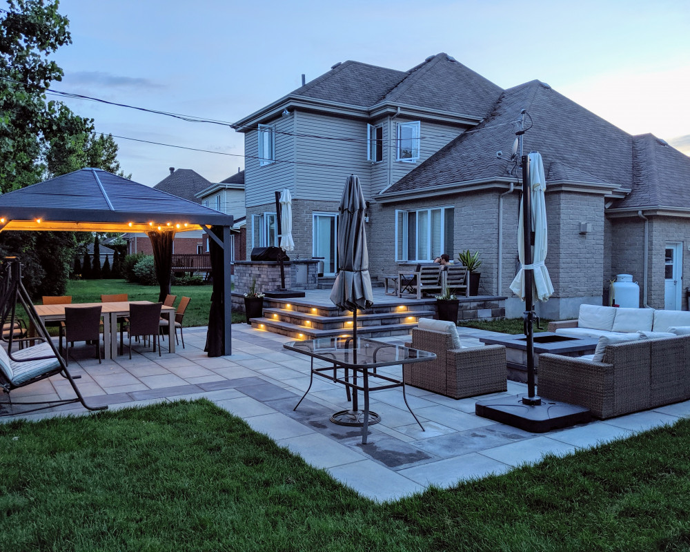 We took on this project and were given freedom to create what we felt best suited the lifestyle of our client.   Some key features: •Outdoor kitchen • Fire feature •landscape lighting  •Smart light and sprinkler system