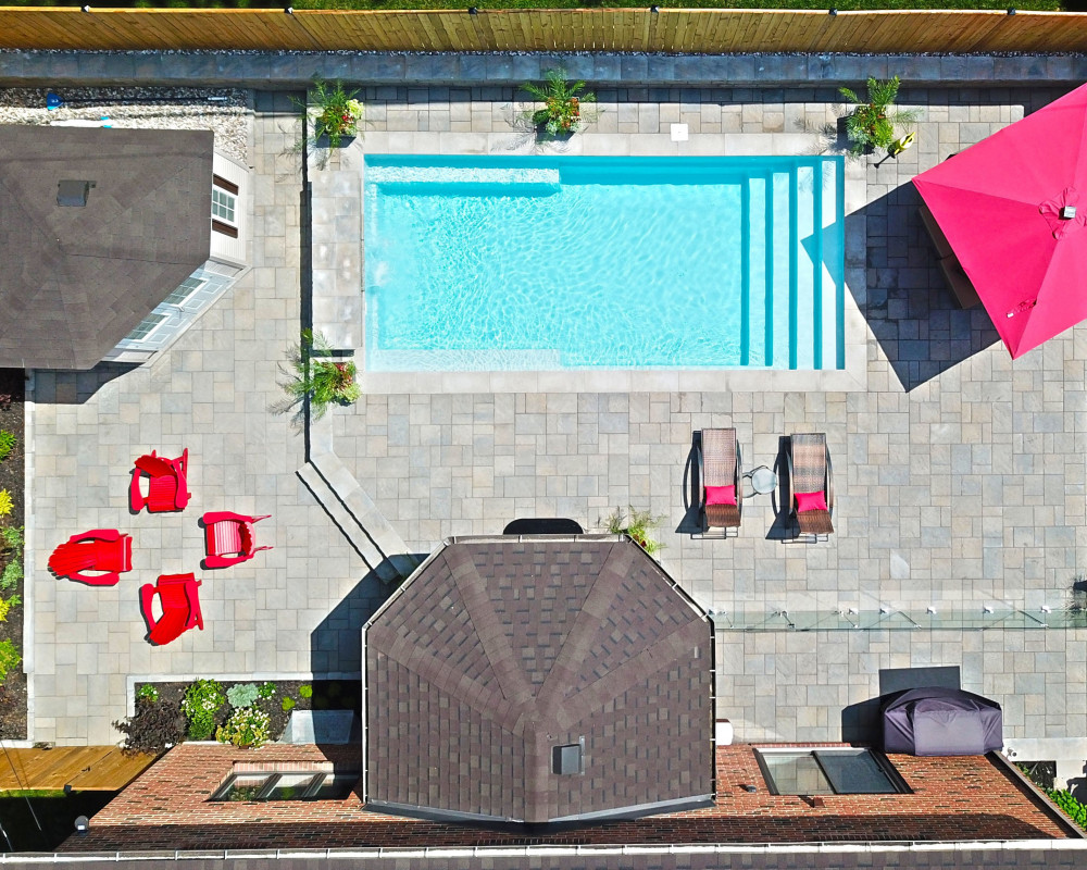 Turn key back yard renovation from installing the pool to choosing the furniture and planting.  key features: • Fibreglass pool • Glass fence • Water feature