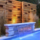 This is an award winning design. One of a kind privacy fence and the sleek look of techo-blocs Graphic wall.
